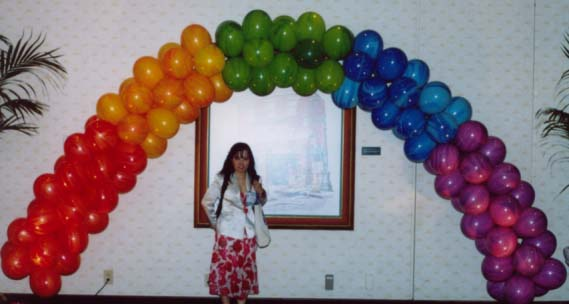 {Fun Rainbow Balloon Arch for your business}
